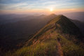 Mountain the way of climax slope have a way for walk background is sunset Royalty Free Stock Photo