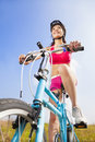 Mountain woman biker and blue sky background Stock Images