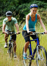 Mountainbike couple outdoors Stock Photos