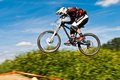Mountainbiker jumping - in motion blurr Stock Image