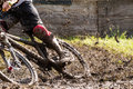 Mountainbiker wit a lot of mud Stock Image
