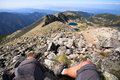 Mountaineer feet mountaineering close up and panoramic view from musala peak in bulgaria Royalty Free Stock Photo