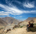 Mountaineer trekker tourist having rest drinking water himalayas mountains ecotourism concept spiti valley near dhankar gompa Stock Image