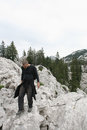 Mountaineer walking the rocks well known croatian historian lovro kuncevic in rocky mountains of velebit enjoying Royalty Free Stock Photo