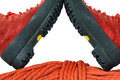Mountaineering boots and rope detail of a rock climbing equipment with a pair of a red isolated on white background Royalty Free Stock Photos