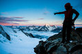 Mountaineering silhouette of a climber on a glacier with high peaks in the background Stock Photography