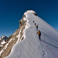 Mountaineers on a range group of are climbing mountain with ropes ice axes and helmets Stock Images