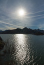 Mountainous Landscape with Sun and Reflection of Light Water Mas Royalty Free Stock Photo