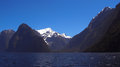 Mountains and fiords in new zealand snow fiordland blue sky Stock Photo