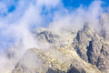 Mountains hight mountain peaks in clouds Royalty Free Stock Photos