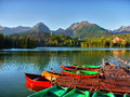 Mountains lake national park colourful boats on alpine in the high tatras slovakia Royalty Free Stock Photos