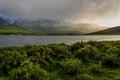 Mountains lake overcast sunlight fog Royalty Free Stock Photo