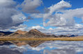 Mountains lake reflection and clouds reflecting in a high altitude in western tibet Stock Photo