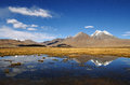Mountains lake reflection and clouds reflecting in a high altitude in western tibet Stock Images
