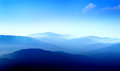 Mountains in layers with blue sky Royalty Free Stock Image
