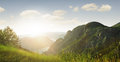 Mountains panoramic view of nice summer sun shines through the mountain Royalty Free Stock Photo