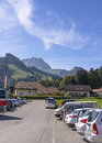 Mountains and parking at the cheese factory gruyere switzerland Royalty Free Stock Photos