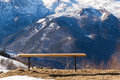 Mountains rest bench with a view on the winter in caucasus area near arkhyz russia Stock Image