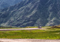 Mountains road car in mountain area altai russia with a going by it surrounded by steppe landscape and at the background Stock Images