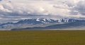 Mountains steppe landscape in the mountain altai area russia with cloudy dull sky and Royalty Free Stock Photos