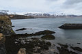 Mountains Surrounding the Rocky Coastline of Hellnar Iceland