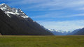 Mountains and valley in new zealand with snow fiordland blue sky Royalty Free Stock Photo