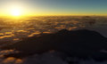 Mountaintop sunset view from above the clouds Stock Image