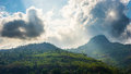 Mountian sunlight through the cloud Royalty Free Stock Images