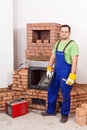 Mounting the door of a brick masonry heater worker with welding equipment Stock Images