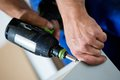 Mounting furniture with screwdriver wooden cordless Royalty Free Stock Photography