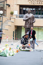 Mourners gather for mandela people and lay flowers in nelson square in sandton city to pay respects to the former leader of south Stock Photos