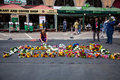 Mourners gather for mandela people and lay flowers in nelson square in sandton city to pay respects to the former leader of south Royalty Free Stock Images