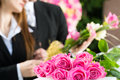 Mourning people at funeral with coffin men and women on pink rose standing casket or Royalty Free Stock Photos
