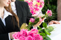 Mourning people at funeral with coffin men and women on pink rose standing casket or Royalty Free Stock Photography