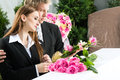 Mourning people at funeral with coffin men and women on pink rose standing casket or Stock Photography