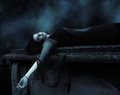 Mourning vamp vampire lying on a tomb Royalty Free Stock Photos