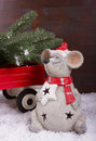 Mouse carrying a christmas tree one is transporting for on trailer Royalty Free Stock Photos