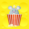 Mouse in cheese popcorn bucket on background Stock Images