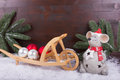 Mouse with christmas preparations with balls and fir branch in snow white red Royalty Free Stock Image