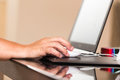 Mouse in hand at work on laptop Royalty Free Stock Photo