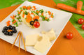 Mouse a kid salad with cheese decorated as a Royalty Free Stock Photos