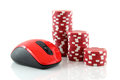 A mouse and red casino chips Stock Images