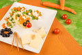 Mouse and vegetables a kid salad with cheese decorated as a Stock Image