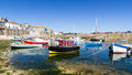Mousehole cornwall england uk summer at the historic fishing harbour europe Royalty Free Stock Photo