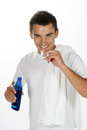 Mouth rinse young man cleaning his Royalty Free Stock Images