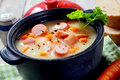 Mouth Watering Hot Creamy Soup Dish with Sausage Royalty Free Stock Photo