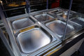 Movable food counter a with stainless steel plates and casters Royalty Free Stock Images