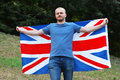 Move to britain young man holding the great flag Stock Images
