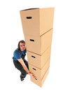 Mover with boxes big stack of heavy Stock Image