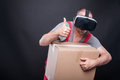 Mover guy holding box wearing vr glasses showing like